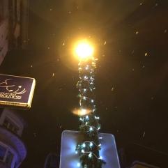Christmas lights and drifting snow flakes