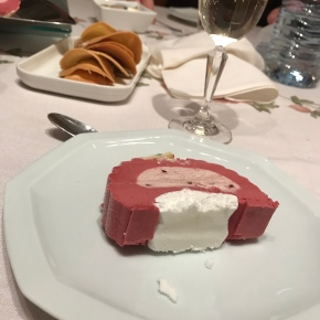 Dessert - raspberry ice cream roll with meringue base